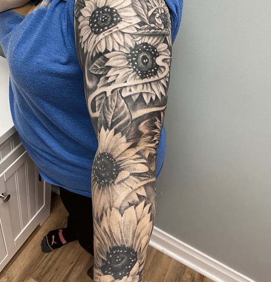 Full sunflower sleeve tattoo by @seansomething