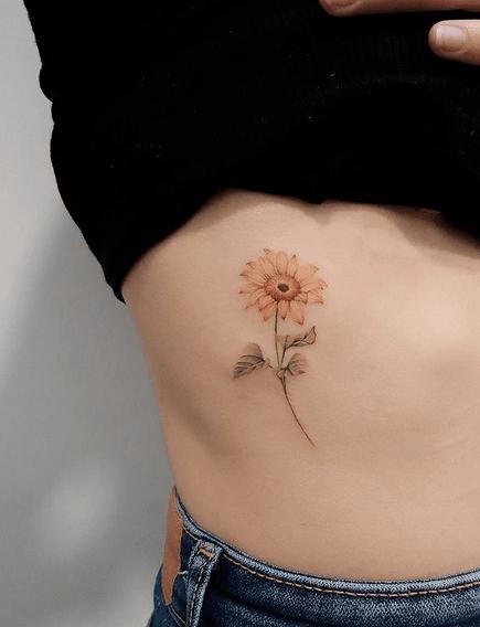 Gentle rib sunflower tattoo by @tiantian_tattooist
