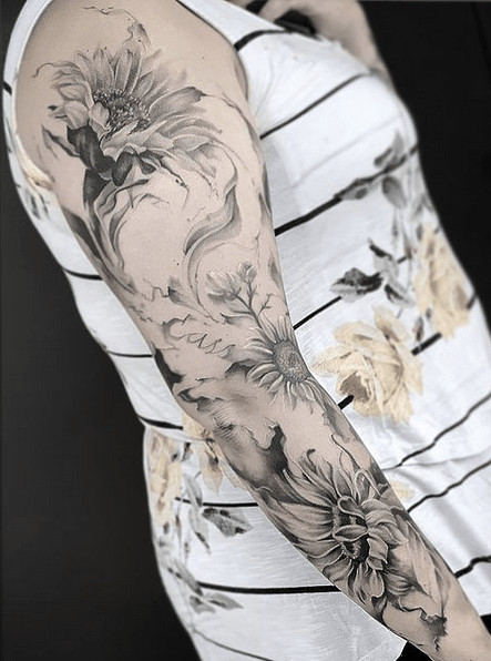 Gentle shading sunflower sleeve tattoo by @motattoos