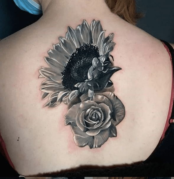 Grey sunflower and rose tattoo by @revivaltattoostudio