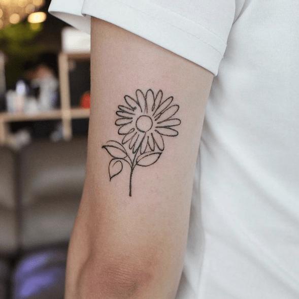 Handdrawn sunflower outline tattoo by @ohoott
