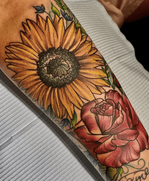 Inner forearm sunflower and rose tattoo by @nickitattoos