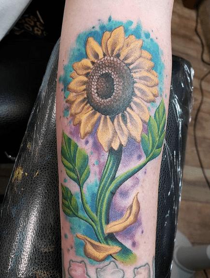 Inner forearm watercolor sunflower tattoo by @kenspraguetattoos