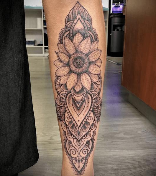 Leg sunflower mandala tattoo by @rietveldtattoo