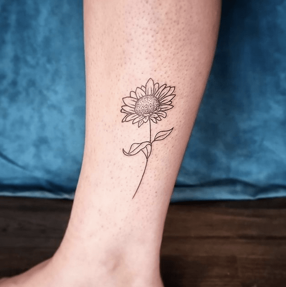 Lovely small sunflower outline tattoo by @galliane_murmures