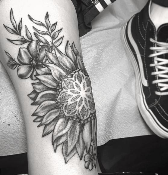 Mandala in a sunflower tattoo by @alexabarricelli