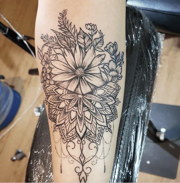 Ornated sunflower mandala tattoo by @anarchyink.777