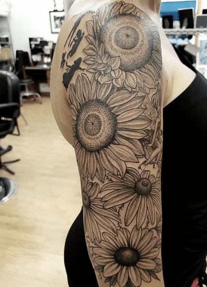 Outline sunflower sleeve tattoo by @kyle_weeden_art