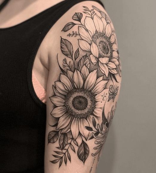 Quarter sunflower sleeve tattoo by @domcalitattoo