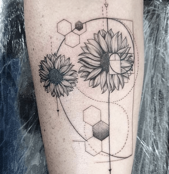 Realistic sunflower with geometric elements tattoo by @sqz_one