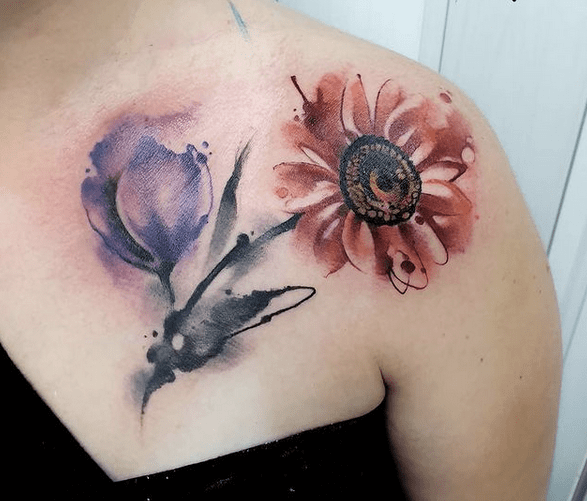 Red and violet watercolor sunflower tattoo by @barbarabuchignani