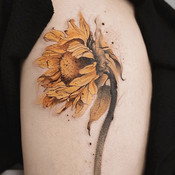 Romantic wind blown watercolor sunflower tattoo by @kickassthings