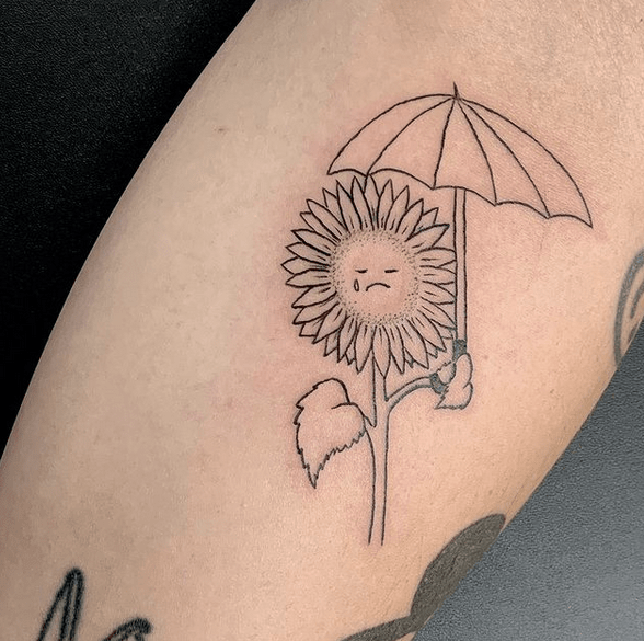 Sad sunflower outline with an umbrella tattoo by @monzart77