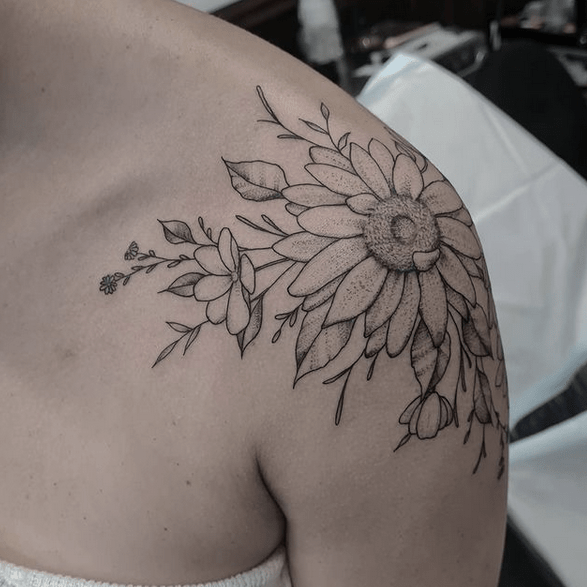 Shoulder sunflower flower tattoo by @katherinejarretattoo