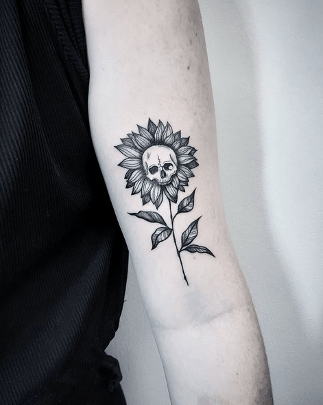 Skull in a sunflower tattoo by @theinkfactory