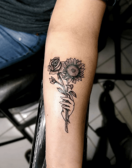 Small black sunflower and rose tattoo by @inkarnationyakima