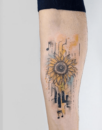 Small forearm watercolor sunflower head tattoo by @tattoo.hysteria.amsterdam