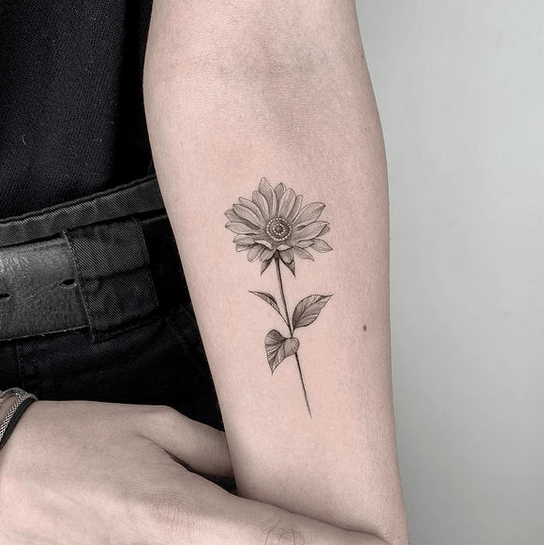 Small inner forearm sunflower tattoo by @paulchiriches.inkpression