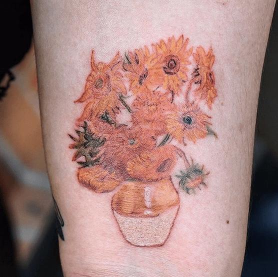 Small orange Van Gogh's sunflower tattoo by @gfitattoo