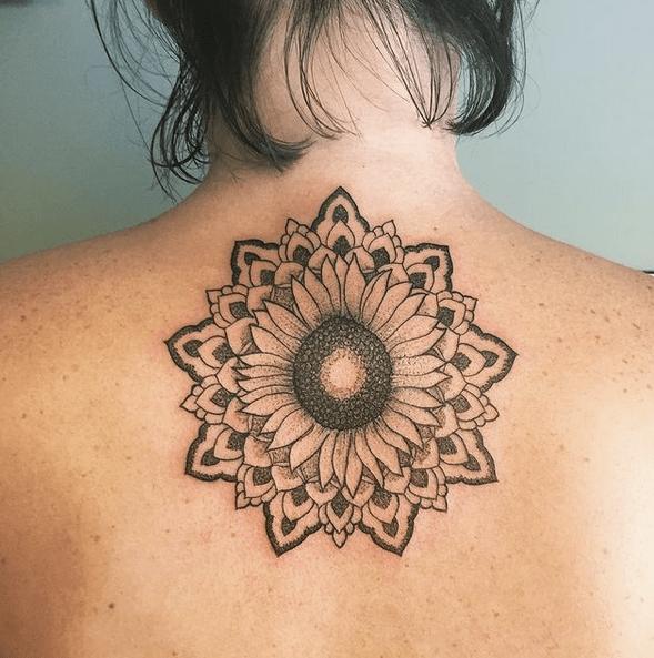 Small outline mandala sunflower tattoo by @travelshetook
