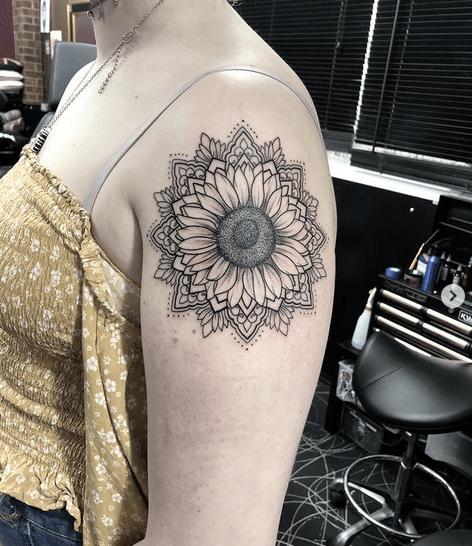 Small shoulder sunflower mandala tattoo by @elliehavis.tattoo