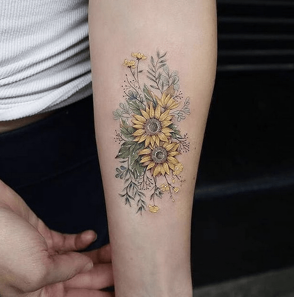 Small sunflower bouquet forearm tattoo by @project.tattoos