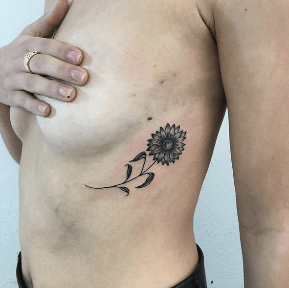 Small underboob sunflower tattoo by @le081