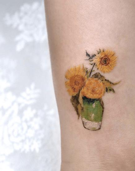 Small vase of Van Gogh's sunflower tattoo by @tattooist_kimria