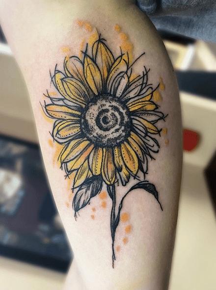 Small yellow watercolor sunflower tattoo by @chris_swenski_tattoo