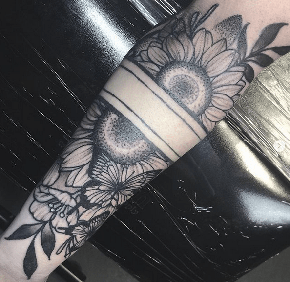 Sunflower halfsleeve tattoo with a band by @kimmykitty347