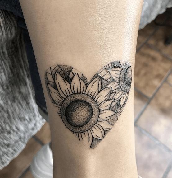 Sunflower heart tattoo by @alelopezink