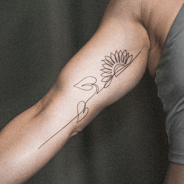 Sunflower outline along the arm tattoo by @dominik_thewho
