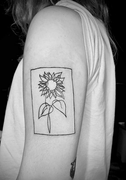 Sunflower outline in a frame tattoo by @brittany.ink