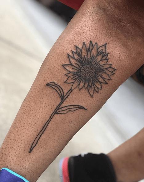 Sunflower outline tattoo by @s0urst0ner