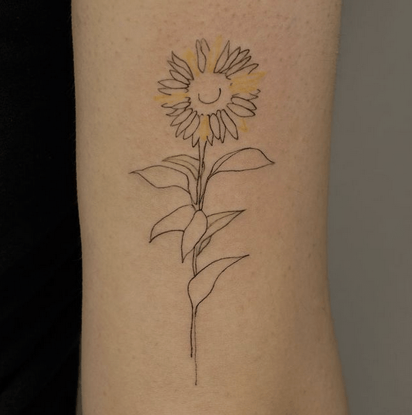 Sunflower outline with yellow petals tattoo by @liaan.tattoo