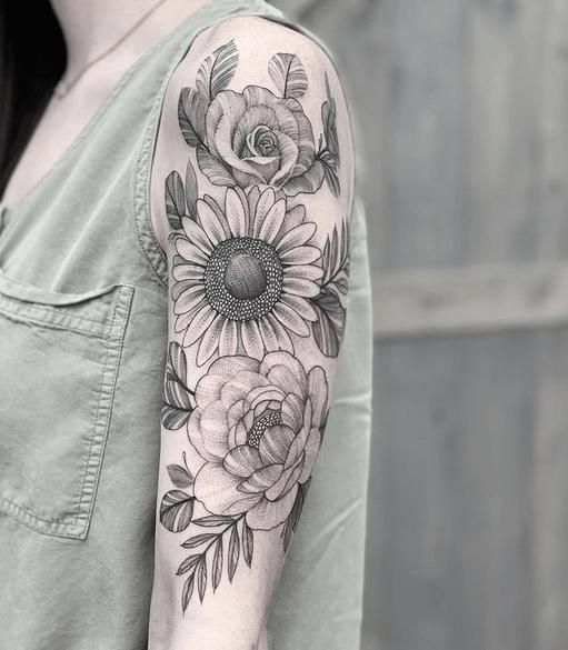 Sunflower peony rose tattoo by @davidbaisatattoos