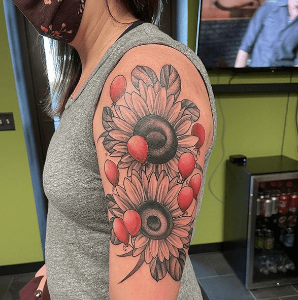 Sunflower sleeve tattoo with balooons by @anovakaine