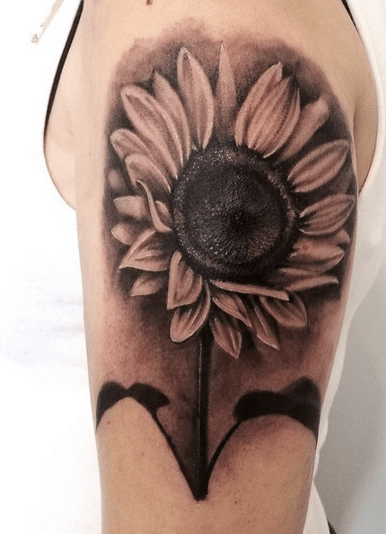 Sunflower with black shading tattoo by @blu_tattooheart