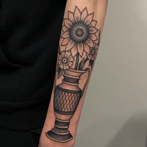 Traditional sunflower in a vase tattoo by @kevinnijsse