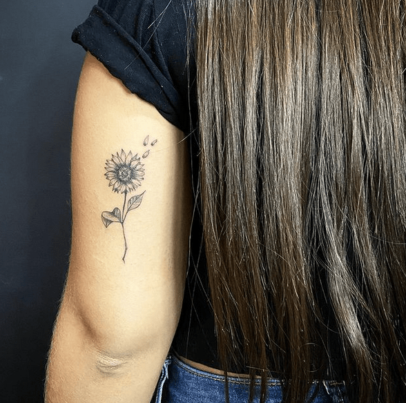 Tricep small sunflower tattoo by @gustav_hild