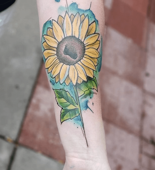 Turqouise watercolor sunflower tattoo by @christopher.tattoos