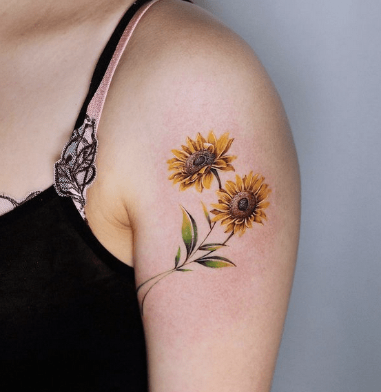 Two small sunflowers tattoo by @honma_tat