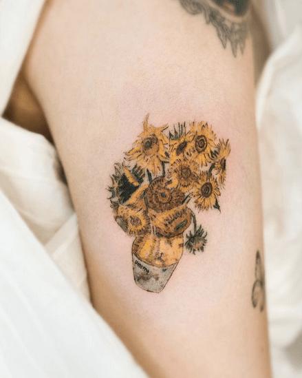 Upper arm Van Gogh's sunflower tattoo by @podo_tattoo