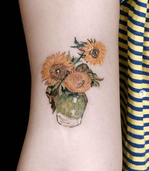 Vase of Van Gogh's sunflowers tattoo by @madkoreatattoo