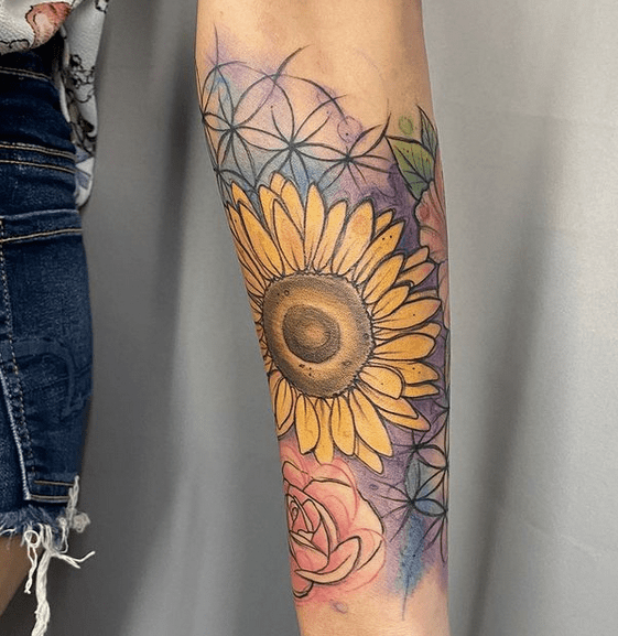 Watercolor sunflower half sleeve tattoo by @constan_tina