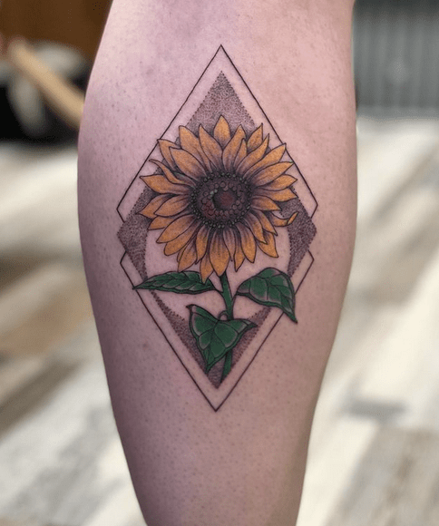Yellow sunflower in a rectangle with shading tattoo by @jorgeets