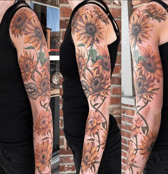Yellow sunflower sleeve tattoo by @brighidkheg