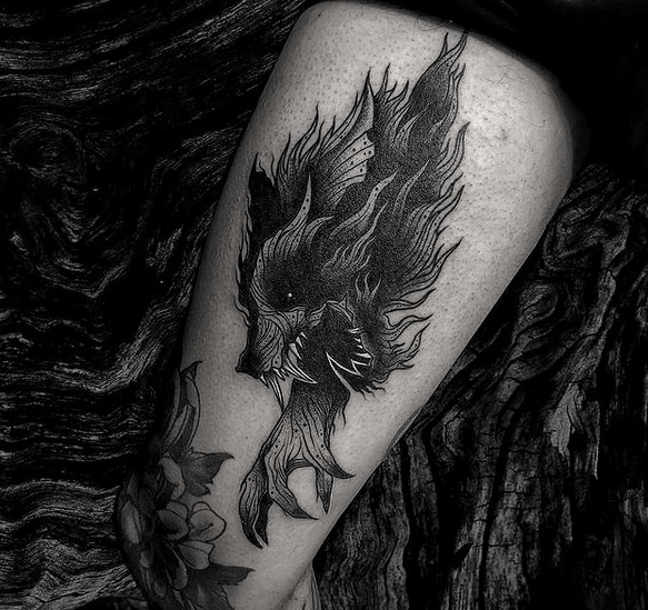 Aggressive small wolf tattoo by @blackartarchivx