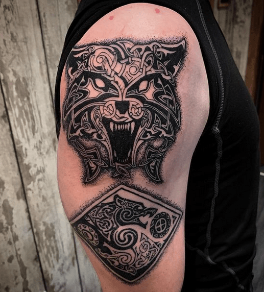 Angry Celtic wolf tattoo by @erin_rae_tattoo