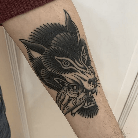 Angry old school wolf tattoo by @pat_karpeza